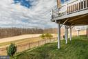 Fenced Rear Yard and expansive deck - 16928 TAKEAWAY LN, DUMFRIES