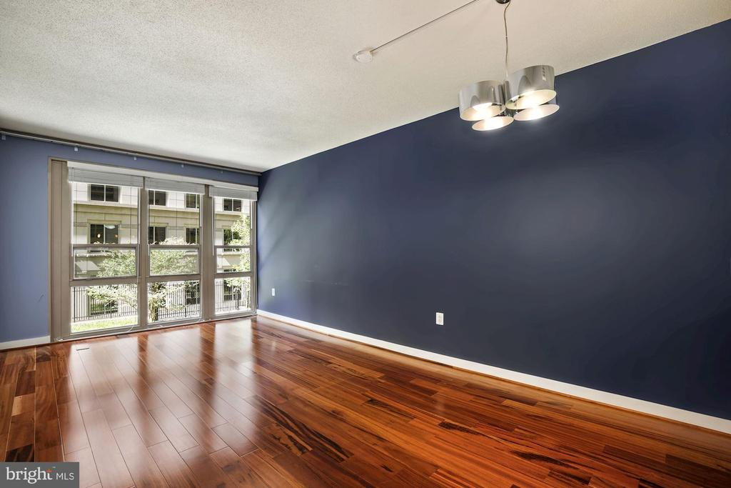 Living Room - Wall of Windows Allow in SO MUCH SUN - 888 N QUINCY ST #207, ARLINGTON