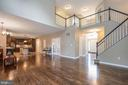 Open floor plan from family room to kitchen - 5 JAMESTOWN CT, STAFFORD