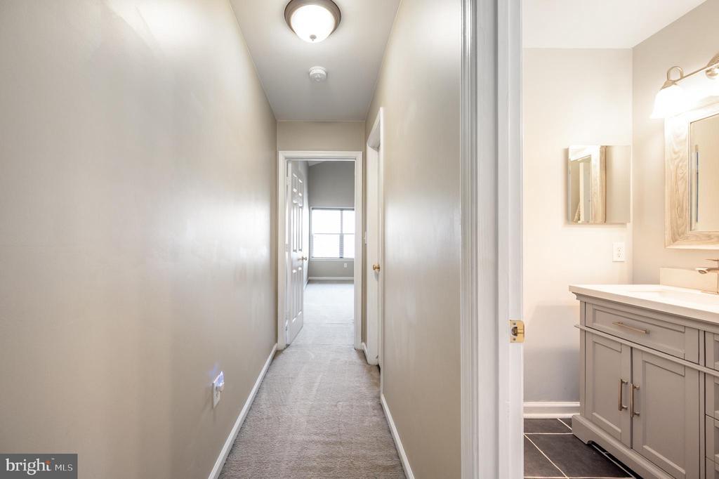 Hallway view to primary bedroom - 5 JAMESTOWN CT, STAFFORD