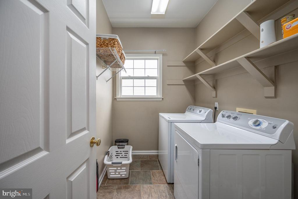 Laundry room with custom shelving - 5 JAMESTOWN CT, STAFFORD