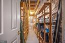 Storage area with custom shelving built in - 5 JAMESTOWN CT, STAFFORD