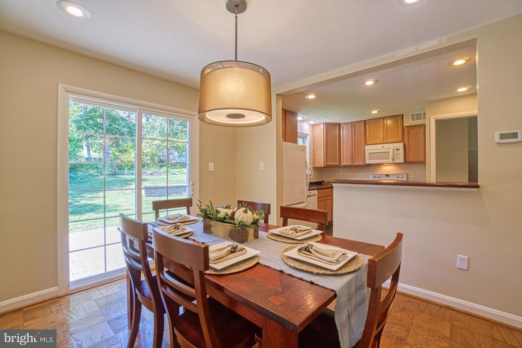 Kitchen is open to Dining Room and Sliding doors - 3130 VALLEY LN, FALLS CHURCH