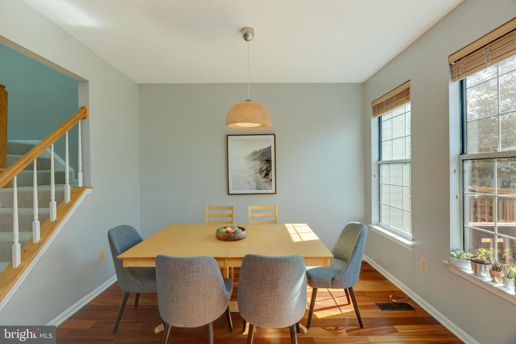 Sun-filled dining room leads to deck - 14641 STREAM POND DR, CENTREVILLE