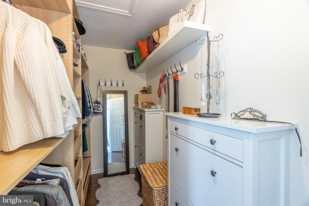 Walk-in closet with built-in shelving - 14641 STREAM POND DR, CENTREVILLE