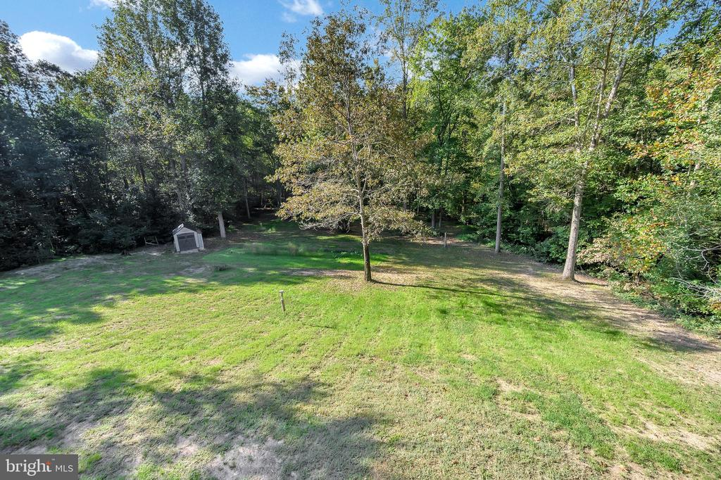 large back yard with a garden - 7900 S WOODS DR, FREDERICKSBURG