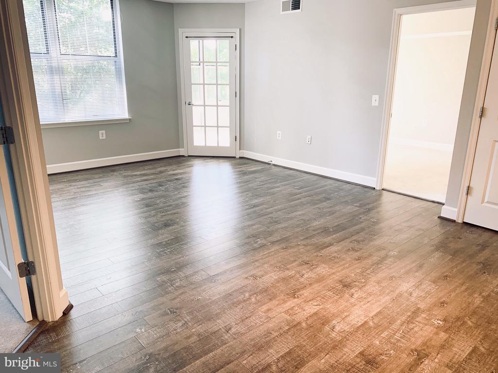 Gleaming floors, French doors & loads of light! - 11800 SUNSET HILLS RD #311, RESTON