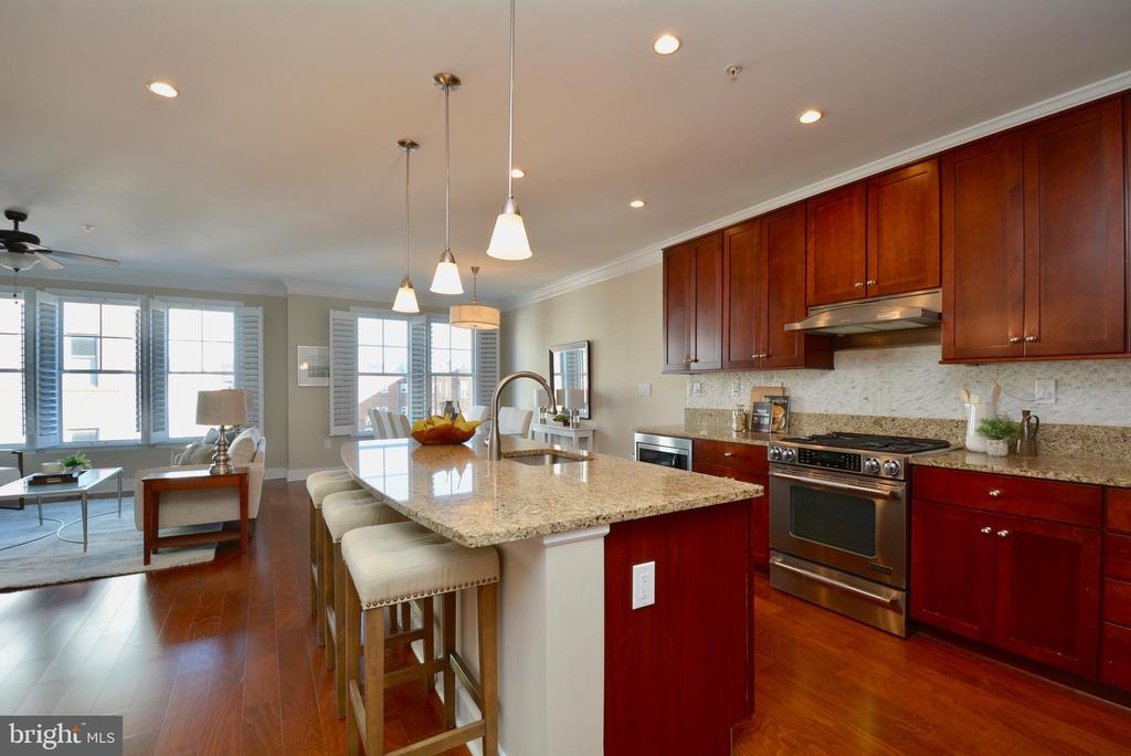 Kitchen with island and granite counters - 1418 N RHODES ST #B410, ARLINGTON