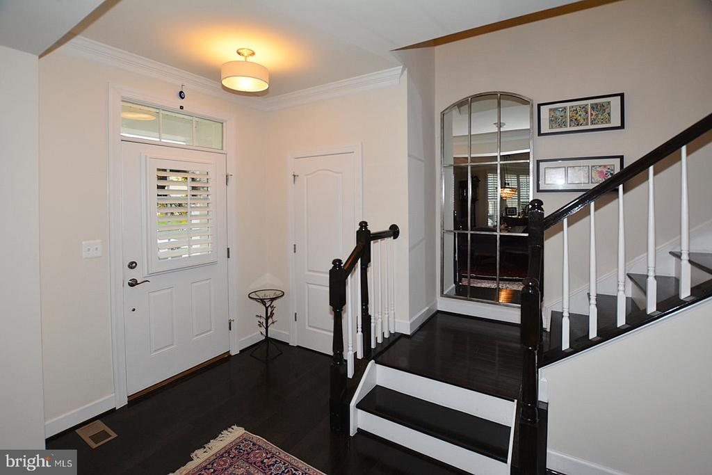 Foyer with hardwood stairs - 7614 CHESTNUT ST, MANASSAS