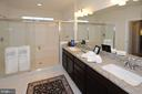 Primary bath with granite and double shower - 7614 CHESTNUT ST, MANASSAS