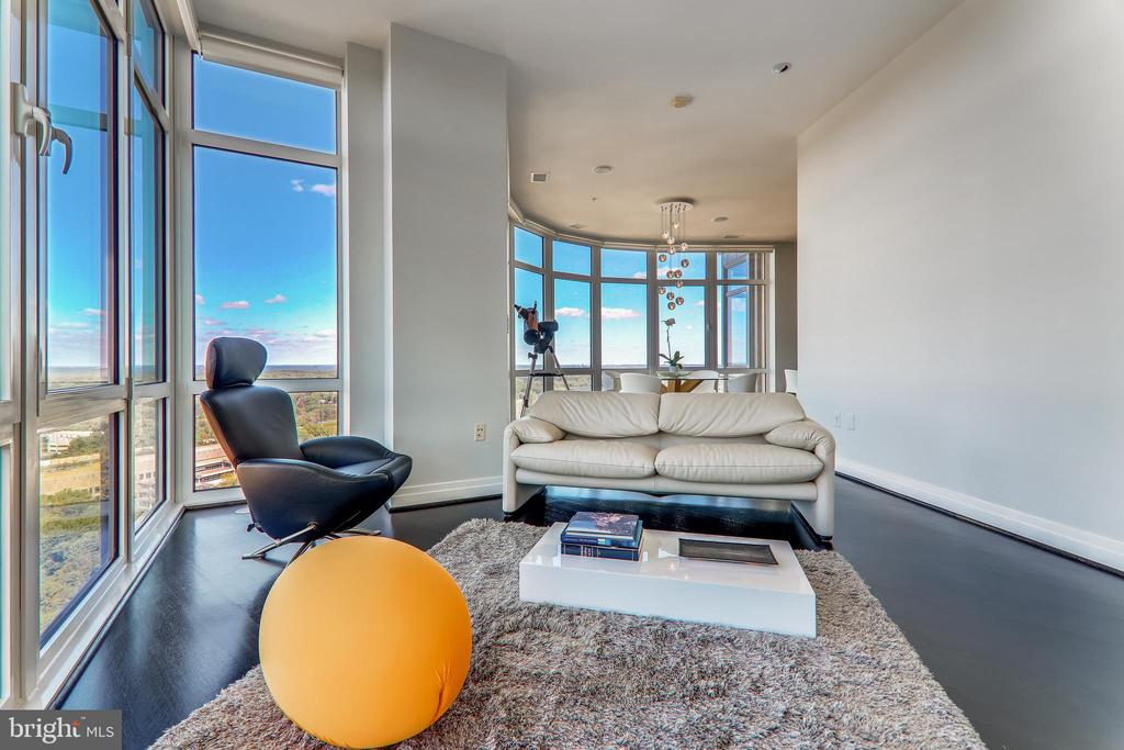 Den with gas fireplace and view of sunset horizon - 8220 CRESTWOOD HEIGHTS DR #1916, MCLEAN