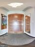 Double entry foyer entryway leading to living area - 8220 CRESTWOOD HEIGHTS DR #1916, MCLEAN