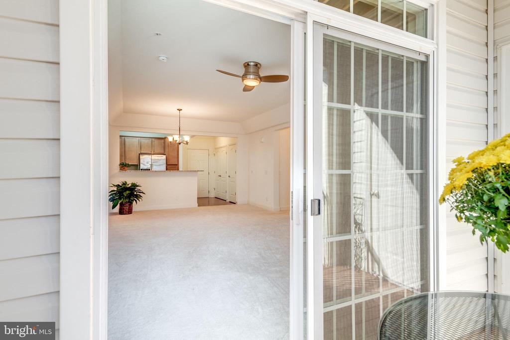 From balcony, looking into your home - 9202 CHARLESTON DR #301, MANASSAS