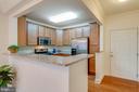 Note easy-care hardwood in entry & kitchen - 9202 CHARLESTON DR #301, MANASSAS
