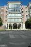 Building front entry - 19350 MAGNOLIA GROVE SQ #211, LEESBURG