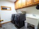 Mudroom/laundry area on main level next to garage - 7755 WALLER DR, MANASSAS