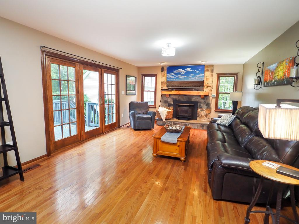 Stone fireplace in family room-walk off onto deck - 7755 WALLER DR, MANASSAS