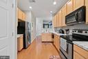Kitchen with hardwood flooring - 42453 ROCKROSE SQ, BRAMBLETON