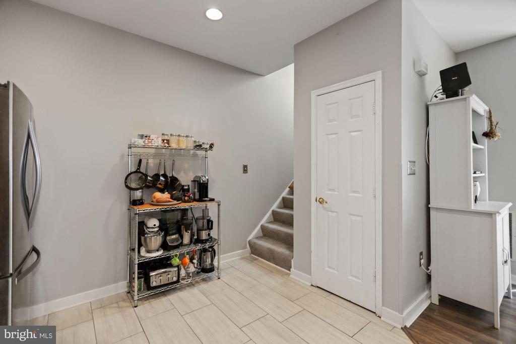 kitchen with view of storage and stairs - 7700 DUNEIDEN LN, MANASSAS