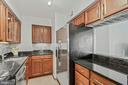 Kitchen open pass-through to the living room - 1301 N COURTHOUSE RD #801, ARLINGTON