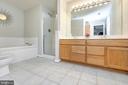 Primary bath double vanity & tile flooring - 20 VAN HORN LN, STAFFORD