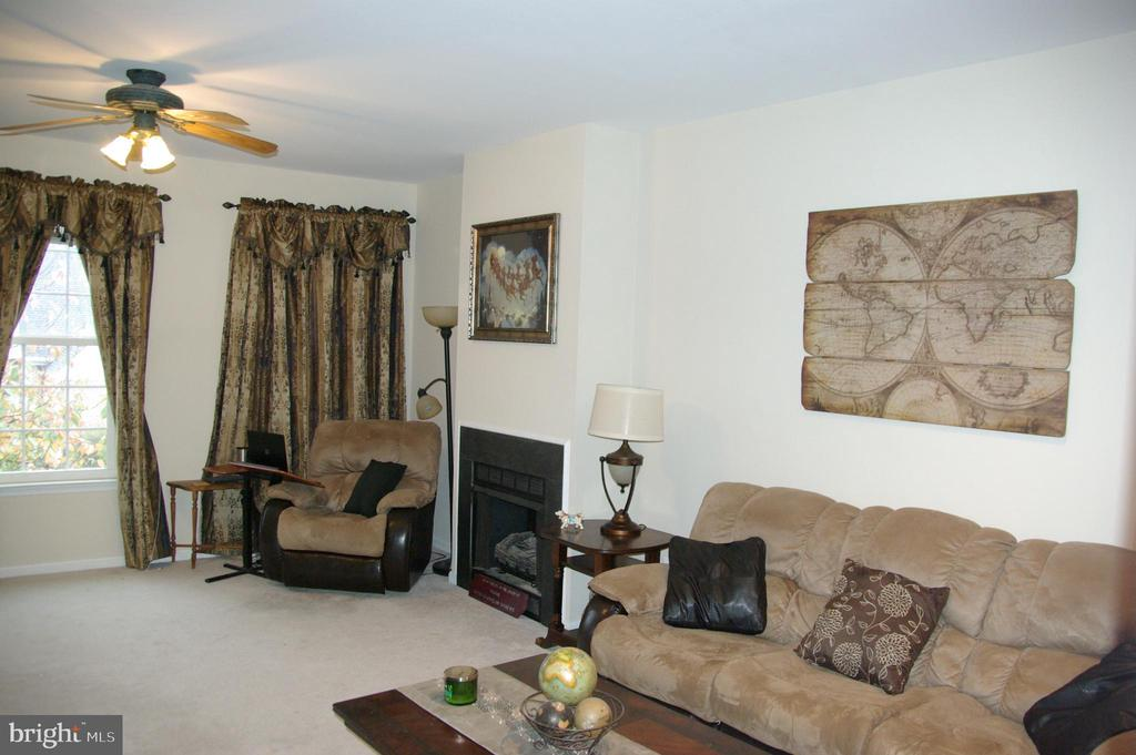 Family Room with gas fireplace - 12889 TITANIA WAY, WOODBRIDGE