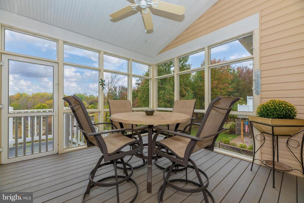 Screened porch with views of green space & trees. - 2513 MILL RACE RD, FREDERICK