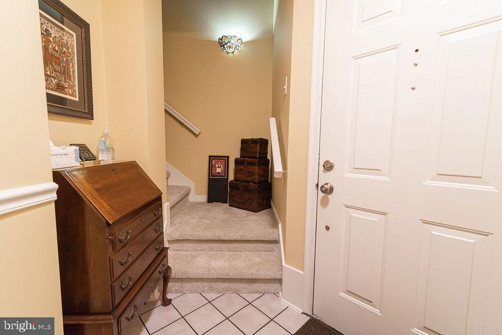 Ceramic tile foyer and new carpet leading to loft - 46580 DRYSDALE TER #300, STERLING