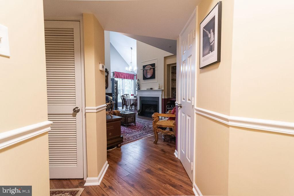 Hallway with gleaming hardwood floors - 46580 DRYSDALE TER #300, STERLING