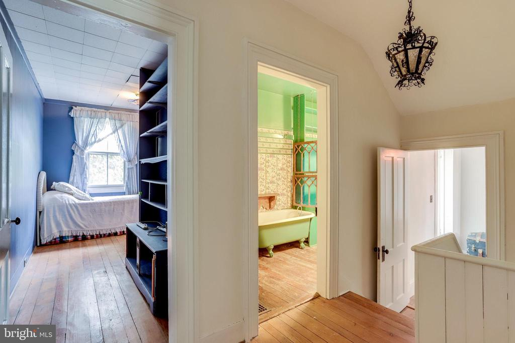 Small hallways between bedrooms, stairs to right - 210 N KING ST, LEESBURG