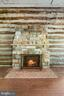 Fireplace in Party Barn lounge - 40568 HIDDEN HILLS LN, PAEONIAN SPRINGS