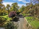 Scenic driveway approach - 40568 HIDDEN HILLS LN, PAEONIAN SPRINGS