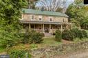 Full length covered Mahogany floored Porch - 19010 GUINEA BRIDGE RD, PURCELLVILLE