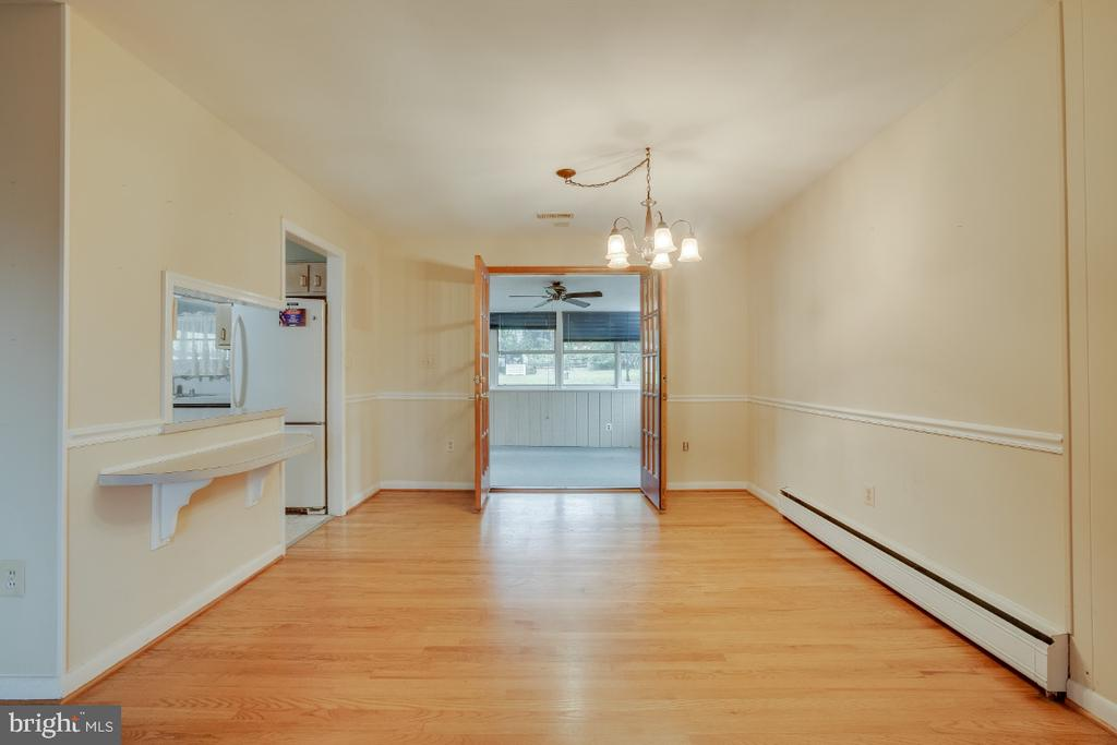 Formal dining room, French doors to sun room - 161 LAWSON RD SE, LEESBURG