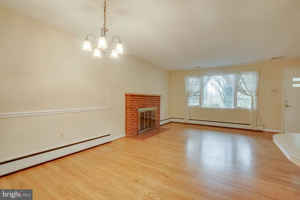 Hardwood floors throughout first level. - 161 LAWSON RD SE, LEESBURG