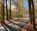 Tree-lined, brand-new circular asphalt driveway - 11798 TARGET CT, WOODBRIDGE