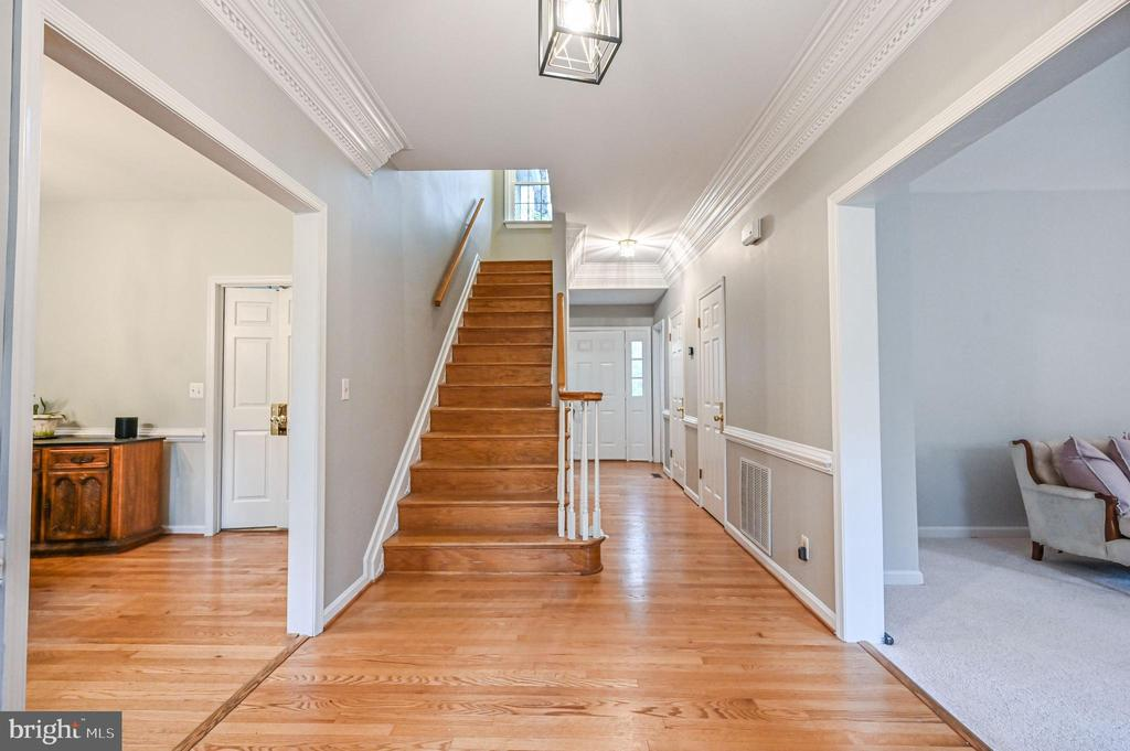 Foyer with Hardwood Floors and Stairs - 5040 CANNON BLUFF DR, WOODBRIDGE