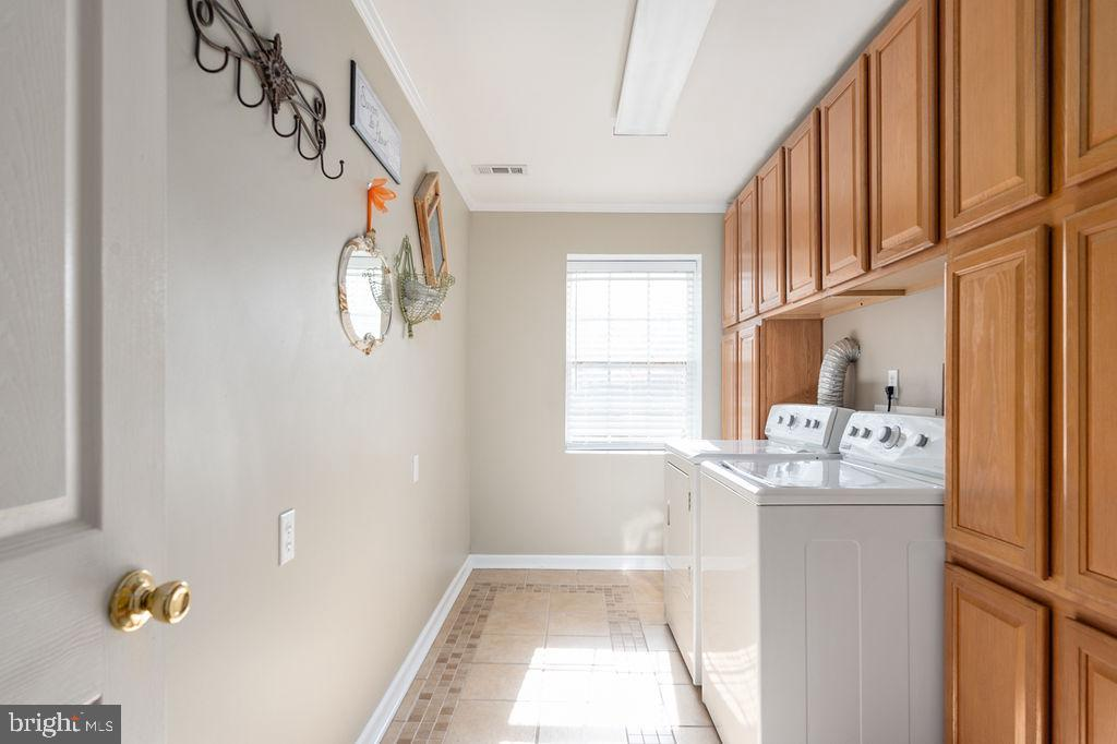Laundry room with plenty of built-in cabinets - 67 CARDINAL FOREST DR, FREDERICKSBURG