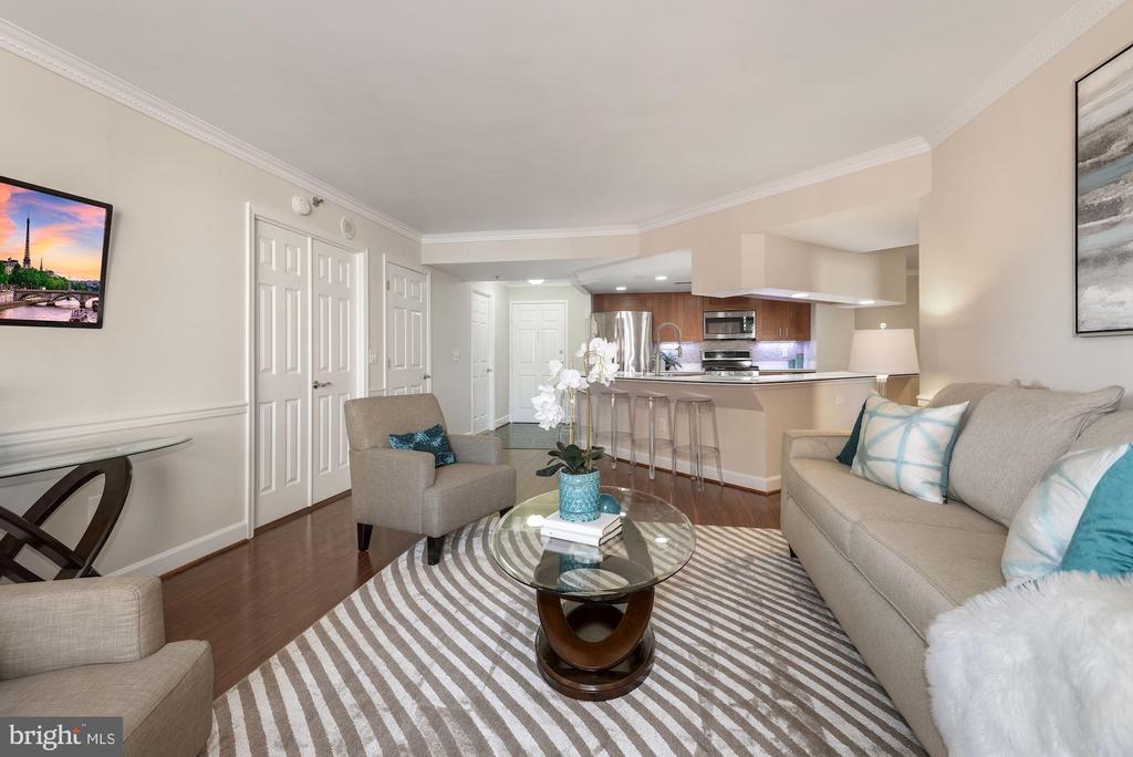 Living Room toward Kitchen. Gleaming  wood floors. - 1276 N WAYNE ST #807, ARLINGTON