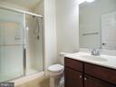 Full bathroom downstairs with tile floor - 14973 SPRIGGS TREE LN, WOODBRIDGE