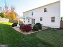 View of back of house - 14973 SPRIGGS TREE LN, WOODBRIDGE