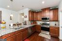 Kitchen with Island and Stainless Steel Appliances - 18228 RED MULBERRY RD, DUMFRIES