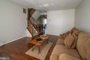 Large living room with upgraded flooring. - 102 TWIN BROOK LN, STAFFORD