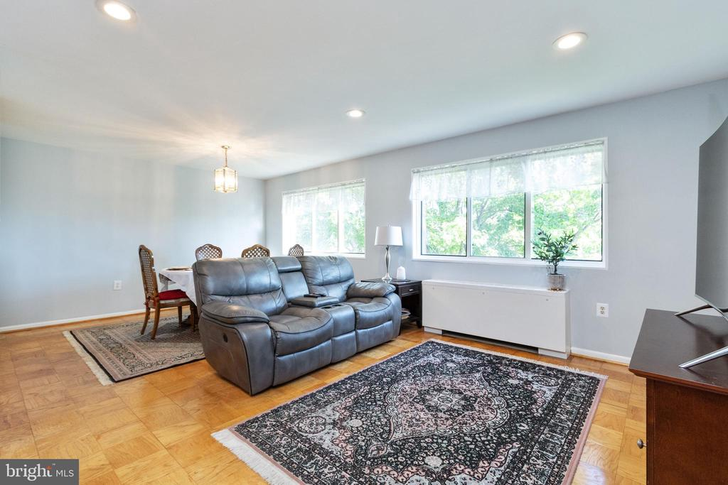 Open dining /living room full of natural light. - 200 N MAPLE AVE #607, FALLS CHURCH