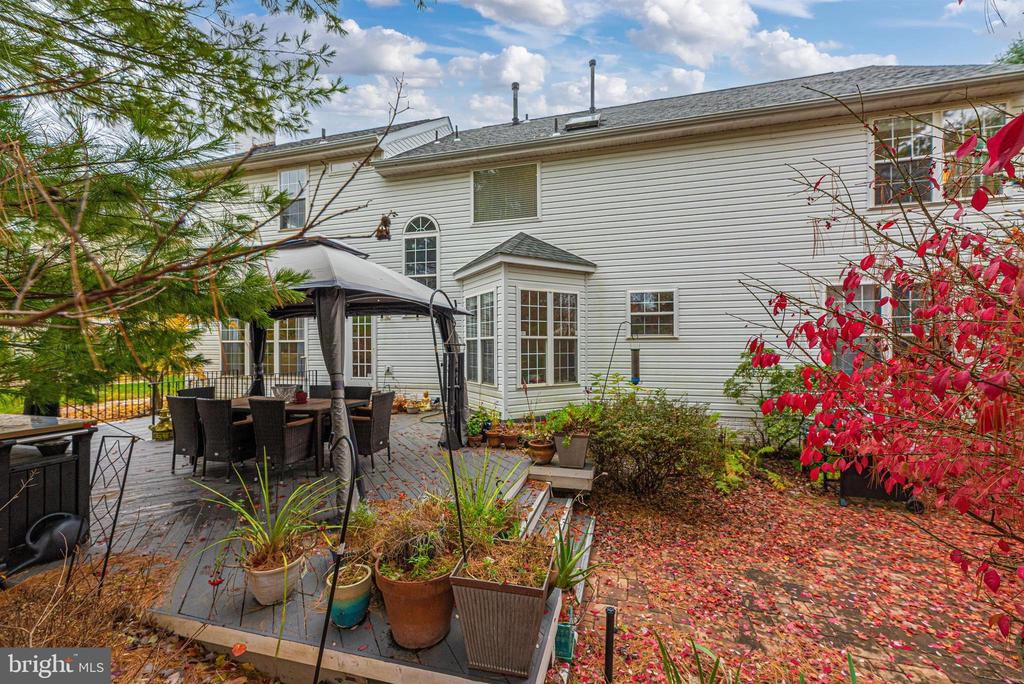 Gorgeous backyard with large deck. - 6287 IVERSON TER S, FREDERICK