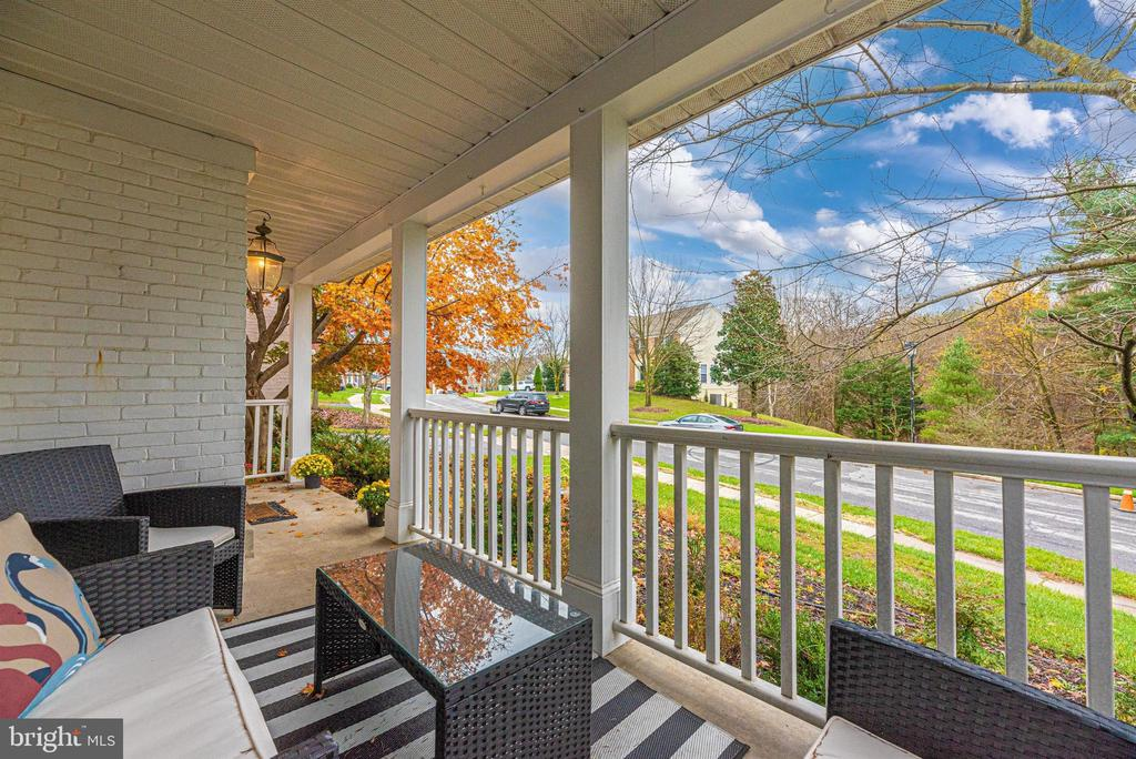Peaceful front porch with views of the woods. - 6287 IVERSON TER S, FREDERICK