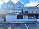 Rear of home with 2 assigned parking spaces - 107 W O ST, PURCELLVILLE