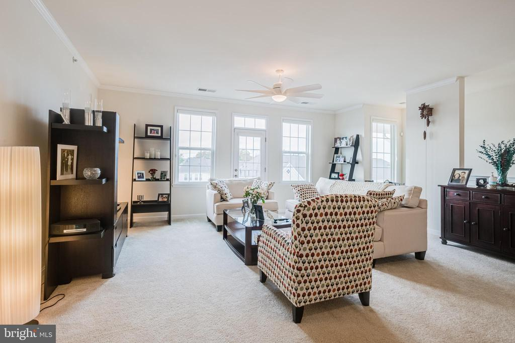 Living room with view from dining room - 24677 LYNETTE SPRINGS TER #302, ALDIE