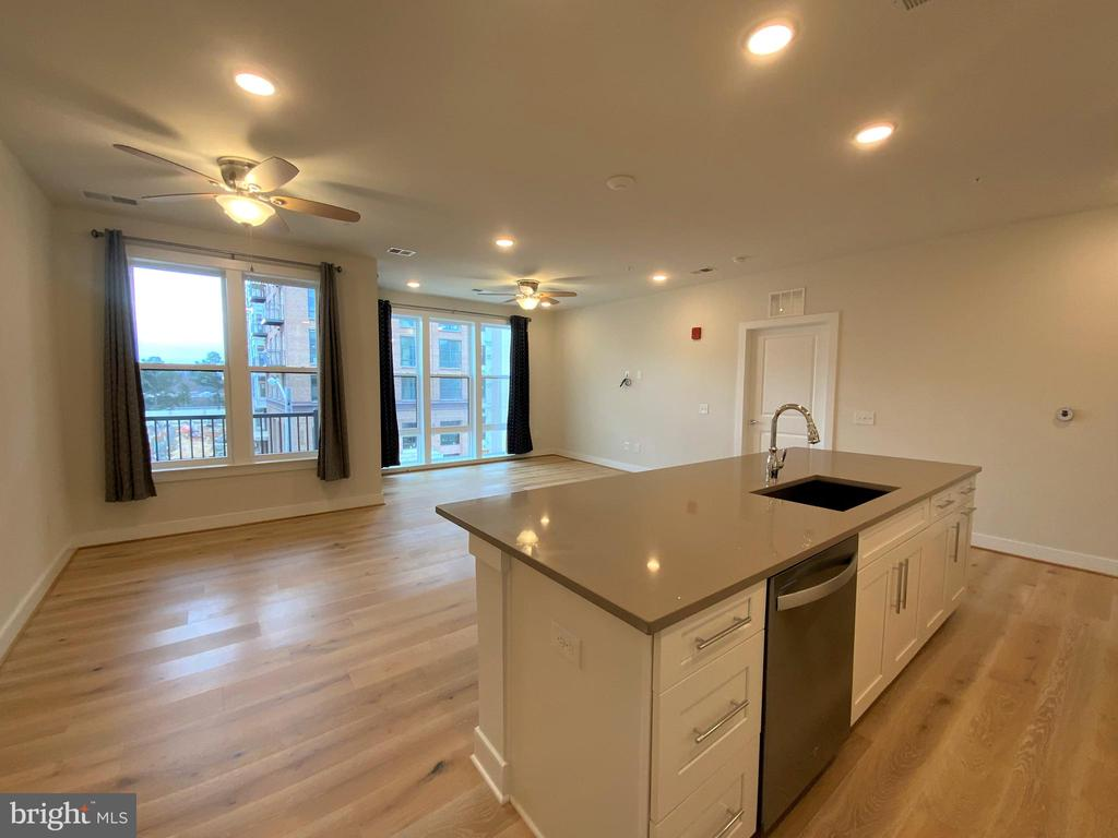 View from kitchen into great room at sunset - 11200 RESTON STATION BLVD #402, RESTON