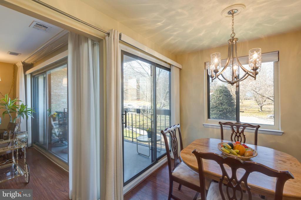 *Two sets sliding glass doors making area bright - 3031 BORGE ST #212, OAKTON